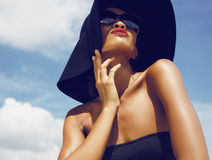 Glamour model in hat under sun Royalty Free Stock Photo