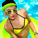 Glamour model in pool hot summer party style Royalty Free Stock Image