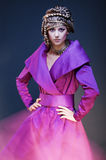 Glamour model in purple dress Royalty Free Stock Image