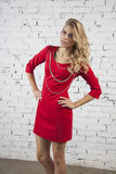 Glamour model in red party dress Stock Image
