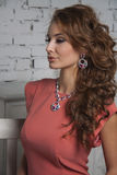 Glamour model with shiny jewelry and curly volume hair Stock Image