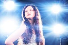 Glamour model superstar. Bright glazing flashes light Royalty Free Stock Photo