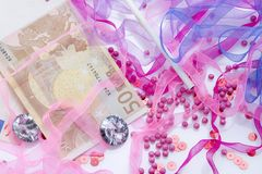 Glamour money. And tablets scattered everywhere Royalty Free Stock Image