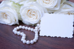 Glamour pearl beads and the white roses Royalty Free Stock Photos