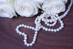 Glamour pearl beads and the white roses Royalty Free Stock Photo