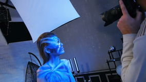 Glamour photographer shoot bodypainting model stock footage