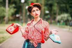 Glamour pin up girl with retro rotary telephones Stock Photo