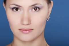 Glamour Portrait. Portrait of a beautiful brunette woman on a blue background Stock Image
