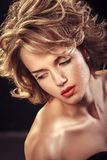 Glamour portrait of beautiful attractive blonde curly woman Royalty Free Stock Photography