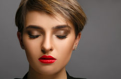 Glamour portrait of a beautiful lady with short hair and proffessional make up. Royalty Free Stock Image