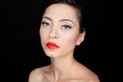 Glamour portrait of a beautiful serious woman with red lips Royalty Free Stock Photography