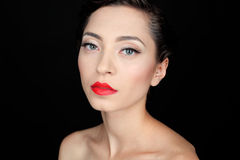 Glamour portrait of a beautiful serious woman with red lips Stock Image