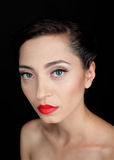Glamour portrait of a beautiful serious woman with red lips Royalty Free Stock Photo