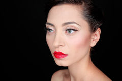Glamour portrait of a beautiful serious woman with red lips Royalty Free Stock Images