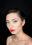 Glamour portrait of a beautiful serious woman with red lips Royalty Free Stock Photos