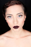 Glamour portrait of a beautiful serious woman with red lips Royalty Free Stock Image