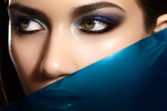 Glamour portrait of beautiful woman model with bright evening makeup with blue color and clean healthy skin face Royalty Free Stock Photos