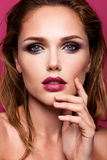 Glamour portrait of beautiful woman model with fresh makeup and romantic wavy hairstyle. Glamour portrait of beautiful girl model with makeup and romantic wavy Royalty Free Stock Photography