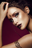 Glamour portrait of beautiful woman model with gold makeup and romantic hairstyle. Stock Images