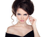 Glamour portrait of beautiful woman model with hairstyle and make up isolated on white background. Jewelry and Fashion. royalty free stock photography