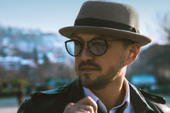 Glamour portrait of beauty man in hat and glasses looking away o Stock Image