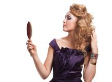 Glamour portrait of blond woman with mirror Royalty Free Stock Image