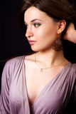 Glamour portrait of elegant woman with earrings stock images
