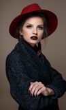 Glamour portrait model in hat and coat, professional make up Stock Photo