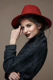 Glamour portrait model in hat and coat, professional make up Stock Photography