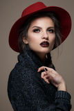 Glamour portrait model in hat and coat, professional make up Royalty Free Stock Photography