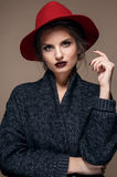 Glamour portrait model in hat and coat, professional make up Stock Images