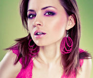 Glamour Portrait of sexy woman. In pink over the green background Stock Photo