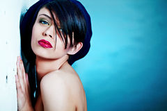 Glamour Portrait of sexy woman. On blue background Royalty Free Stock Photo