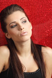 Glamour portrait of sexy woman. On red background Royalty Free Stock Photography