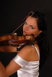 Glamour portrait of sexy woman playing violin Stock Photography
