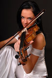 Glamour portrait of woman playing violin stock images