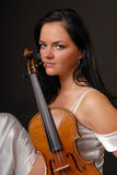 Glamour portrait of sexy woman playing violin Royalty Free Stock Photos