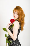 Glamour portrait of sexy woman with red rose Stock Images