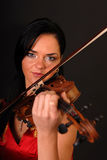 Glamour portrait of sexy woman with violin. Black background Royalty Free Stock Photos
