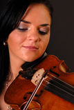 Glamour portrait of sexy woman with violin. Black background Stock Photography