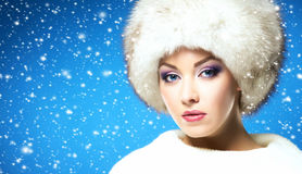 Glamour portrait of a young and beautiful woman in a winter hat Stock Photography