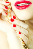 Glamour red lips. And nails with pearls stock photos