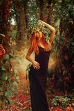 Glamour redhair lady with wreath of hop in magic forest Royalty Free Stock Image
