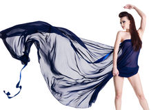 Glamour sensuality woman with chiffon. Glamour sensuality beautiful young woman in blowing dark blue chiffon - isolated on white Stock Images