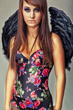Glamour sexy dark angel girl Stock Image