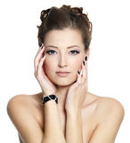 Glamour young woman with black nails and eye make-up. Portrait of glamour young woman with black nails and eye make-up, posing on white background royalty free stock photography