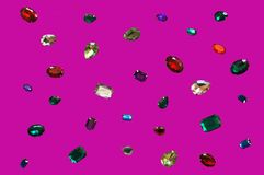 Glamour shiny stones sparkling jewelry glitters gems frame background. Pink Colorful glamour shiny stones sparkling jewelry glitters gems frame background Stock Photos