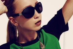 Glamour in sunglasses Stock Photo