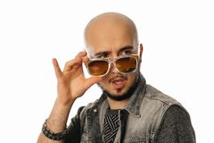 Glamour unshaved man looking away with sunglasses in his hands Royalty Free Stock Images