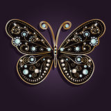Glamour vector golden butterfly. Glamour vector vintage golden butterfly with elegance ornament encrusted with blue jewels on dark purple background Stock Photo